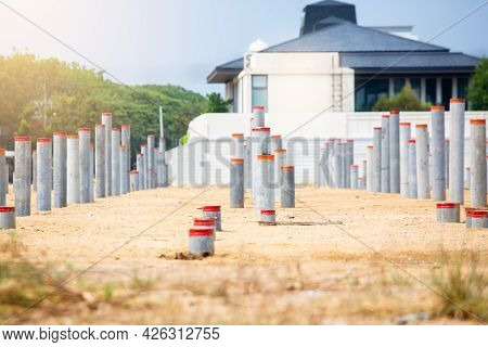 Selective Focus To Many Round Prestressed Concrete Piles That Have Been Hammered Into The Ground In