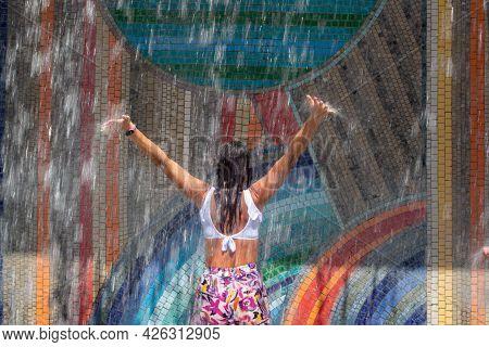 Wet Girl Under The Fountain Gets Wet In Summer