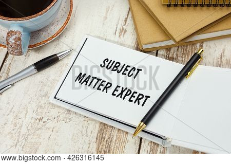 Handwriting Text Subject Matter Expert On The Notepad On The Background Of The Office Desk