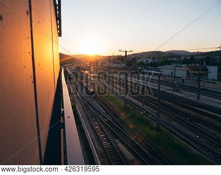 Sunset At Wien Huetteldorf Train Station In Vienna, Austria With Railway Tracks From Above