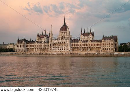 Hungarian House Of Parliament Building In Budapest, Hungary, On The River Danube At Dusk In The Even