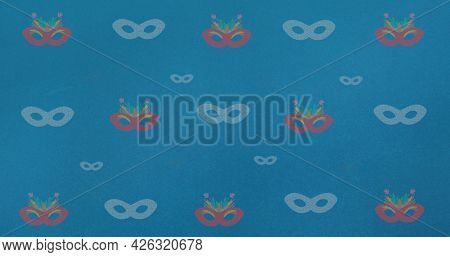Composition of masquerade masks repeated in rows, on blue background. fashion, beauty and accessories background pattern concept digital animation.