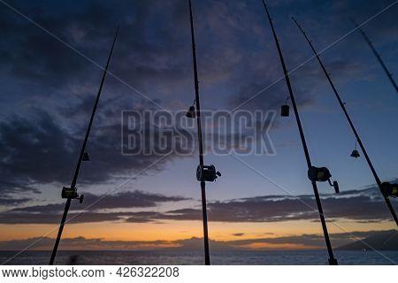 Fishing Trolling In Rod Holder. Big Game Fishing. Fishing Reels And Rods Pattern On Sea. Ocean Fishi