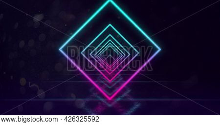 Image of glowing neon turquoise and pink diamond outlines moving towards camera in hypnotic motion in repetition on black background. Neon kaleidoscopic motion concept digitally generated image. 4k