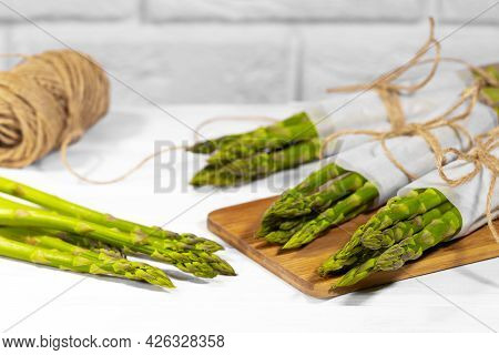 Asparagus, Fresh Raw Organic Green Asparagus Sprouts Closeup, Healthy Vegetarian Food. Raw Vegetable