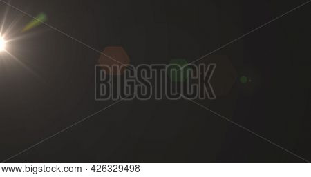 Image of glowing yellow spot of light flickering in hypnotic motion in seamless loop on brown background. Light colour and movement concept digitally generated image.