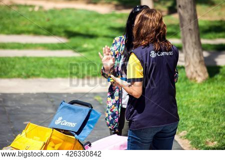 Torrevieja, Spain, 25.05.2021, Correos Is A Spanish Post Delivery, Correos Worker With Performing De