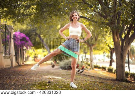 Exercise With Fitness Rubber Bands Outdoor. Fitness And Healthcare Concept