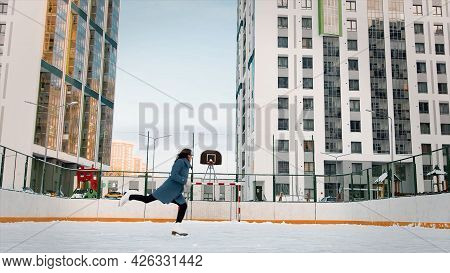 Professional Female Ice Figure Skater Practicing Spinning On Outdoor Skating Rink. Video. Woman Ice