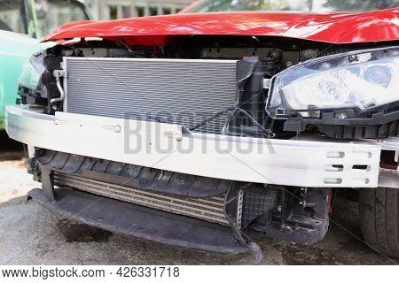 Closeup Of Red Wrecked Car In Repair Shop