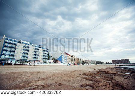 Torrevieja, Spain, 27.04.2021, Sandy Beach Of Mediterranean Sea In Torrevieja City, Costa Blanca