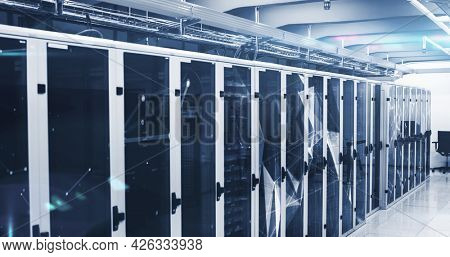 Image of digital data processing flowing through network of computer servers in server room with networks. Global network of data processing centre concept digitally generated image.