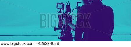 Film Production. Back Of Videoographer And Film Crew Team With 4K Video Camera