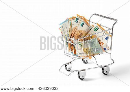 Euro Banknotes In A Trolley On A White Background. Concept.