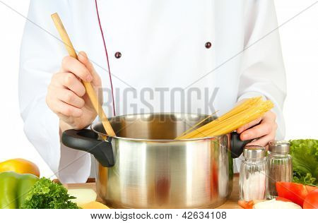 Female hands preparing pasta, isolated on white