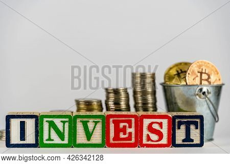 Money Coins Stack Stair As Step Growing Growth And Wooden Cube Block With Word Invest. Investment An
