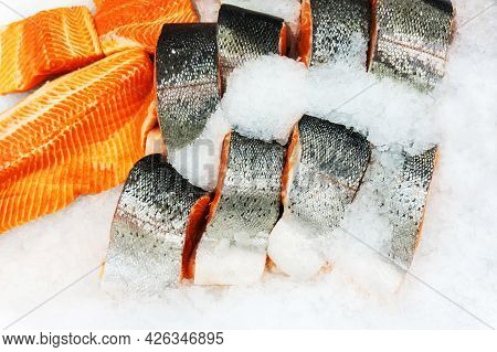 Large Pieces Of Trout In The Ice Crumb. Fish On The Counter In The Store. Trade In Seafood.