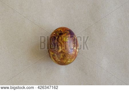 One Egg, Painted In Brown Colors, On Kraft Paper. Minimalism Concept. Unusual Pattern On Surface Of
