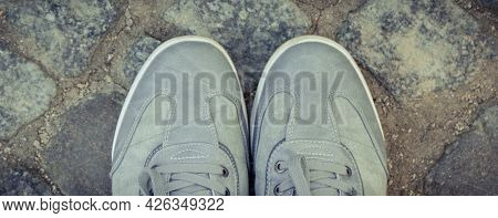 Comfortable Casual Gray Leather Shoes For Men On Road Or Footpath Made Of Rocks Or Stones. Male Foot