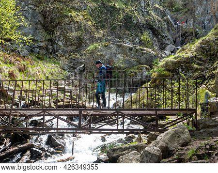 Dombay, Russia - May 18, 2021: Beautiful Waterfall Shumka Located Near Dombay. People Are Fond Of Hi