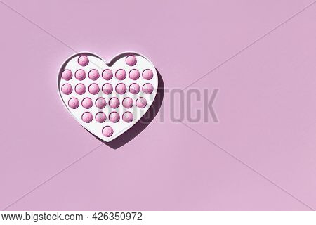 The Popular Educational Toy Of 2021 - Silicone Antistress Pop It Of Lilac Color In A Heart With The
