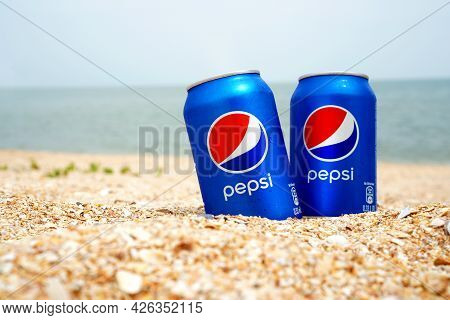 Strelkovoye, Ukraine - 23 June 2021: Illustrative Editorial Of Two Cold Pepsi Cans On The Beach. Thi