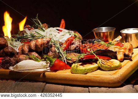 Assorted Barbecue And Grilled Meat With Vegetables Close-up