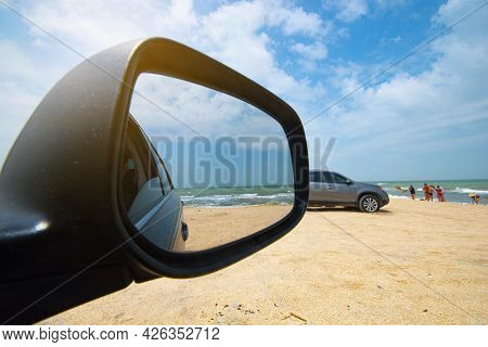 Sea View Through The Side Mirror Of The Car. Car On The Seashore.