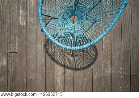 Summer Wicker Chair On The Wooden Terrace In A Sunny Day