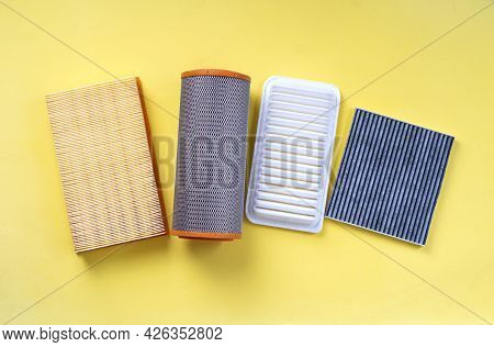 Assortment Of Car Air Filters On A Yellow Background.