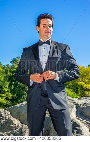 A Professional Executive Is Dressing In A Black Tuxedo, Looking Down And Thinking.