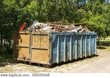 Garbage Container Equipped For Transportation By Truck, Filled With Construction Debris Large Iron C