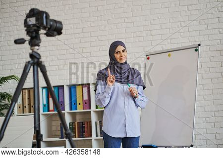 Muslim Female Business Coach Making A Video Of Her Lecture