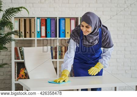 Muslim Woman Cleaning A Workspace At An Office