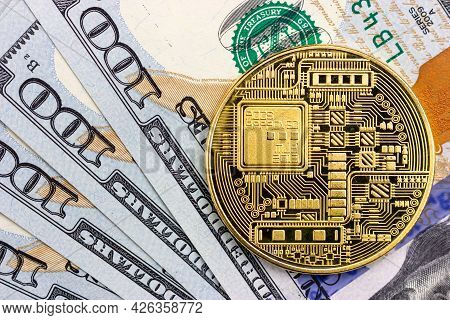 Bitcoin Coin On The Background Of One Hundred Dollar Bills. Blockchain Technologies.