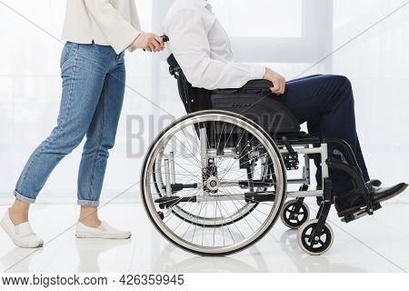 Low Section Woman Pushing Man Sitting Wheelchair. High Quality Beautiful Photo Concept