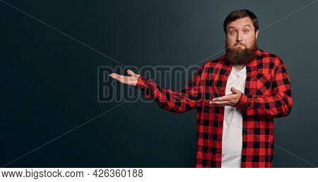 Upset And Hesitant Young Male Coworker Discuss Project With Coworkers, Pointing Left, Introduce Awfu