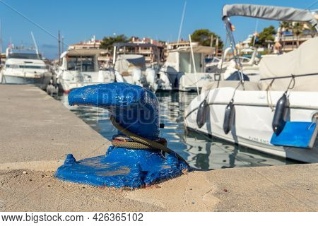 Close-up Of A Blue Boat Mooring With Boats Moored In The Background And Out Of Focus. Island Of Mall