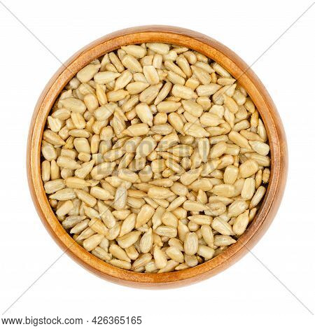 Hulled Sunflower Seeds, Roasted And Salted, In A Wooden Bowl. Crunchy Kernels, Fruits Of The Common