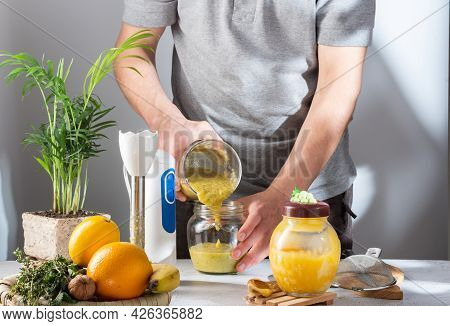 Pour The Jam Into A Glass Jar. Pour From Jar To Jar. The Cook Pours Jam Into Jars.