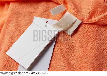 Mockup Template Composition On Orange Cloth And White Blank Empty Paper Price Tag. Paper Labels On C