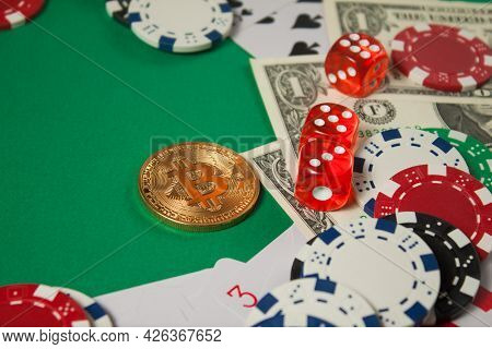 Classic Playing Cards, Chips, Red Dice, Bitcoin And Dollars On Green Background.