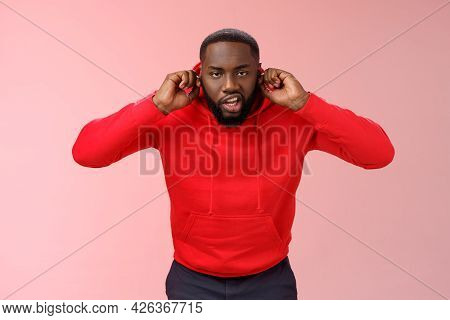Annoyed Funny Irritated Young African-american Bearded Guy Bending Forward Close Ears Plug Index Fin