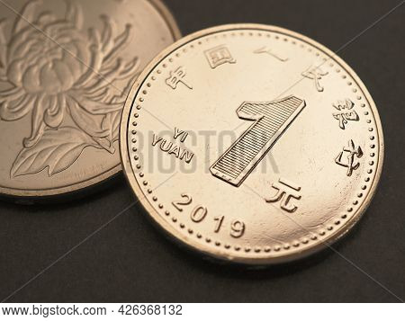 1 One Chinese Yuan Coin Close-up. Yellow Or Light Brown Tinted Illustration About The Economy, Busin