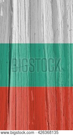 Fragment Of The Flag Of Bulgaria On Dry Cracked Wooden Surface. It Seems To Flutter In The Wind. Ver