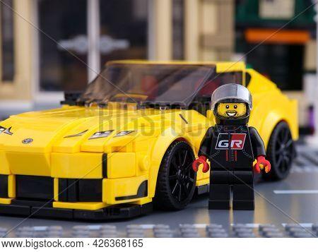 Tambov, Russian Federation - July 02, 2021 Lego Driver Minifigure Near His Car Toyota Gr Supra By Le