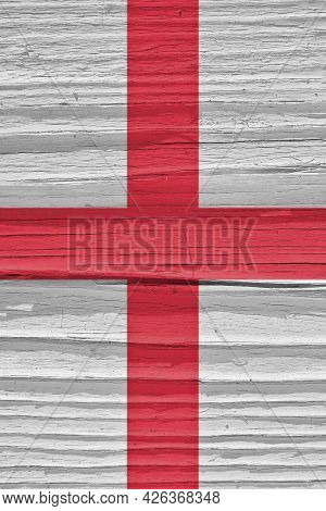The Flag Of England On A Dry Wooden Surface, Cracked With Age. It Seems To Flutter In The Wind. Vert