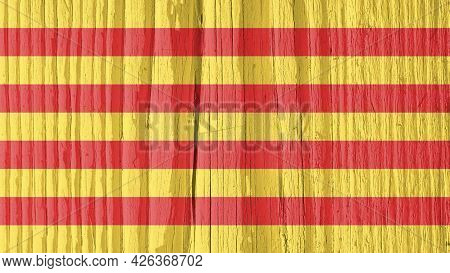 Catalonian Flag On Dry Wooden Surface, Cracked With Age. It Seems To Flutter In The Wind. Background