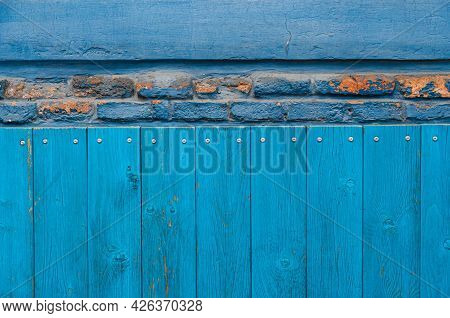 Vintage Wood Background With Peeling Paint And Row Of Dilapidated Bricks. Old Wall Textures Closeup.