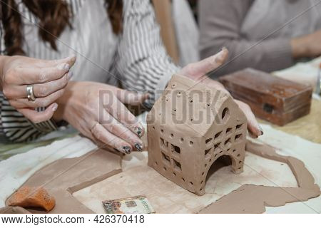 Women's Hands Knead Clay, Drawing Elements Of The Product. Production Of Ceramic Products At The Mas